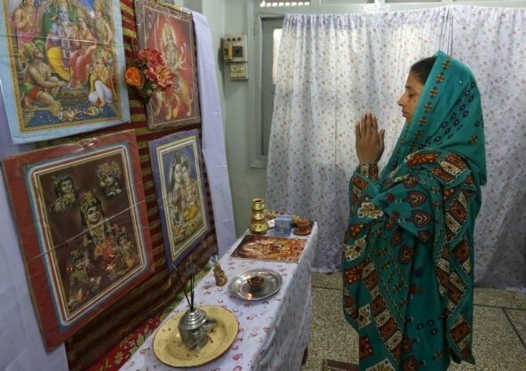 Geeta prays at the Bilquis Edhi Foundation in Karachi, Pakistan, August 6, 2015. The 23 year old deaf-mute Indian girl is believed to have mistakenly crossed into Pakistani territory as a child. Faisal Edhi, managing trustee of Edhi Foundation, said Geeta may be from Jharkhand or Telangana state in India. REUTERS/Akhtar Soomro - RTX1NAB9