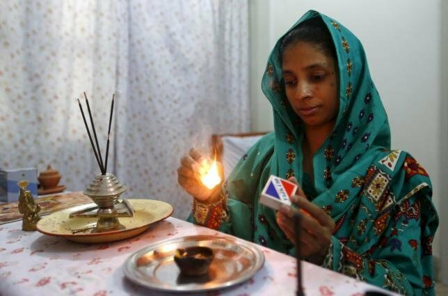 Geeta lights a match as she prepares to pray at the Bilquis Edhi Foundation in Karachi, Pakistan, August 6, 2015. REUTERS/Akhtar Soomro